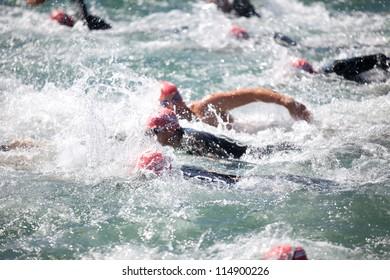 PRANGINS, SWITZERLAND - SEPTEMBER 7: Unidentified triathlon Athletes swim in the lake in the 2011 X-Terra Triathlon , September 7, 2011 in Prangins, Switzerland.