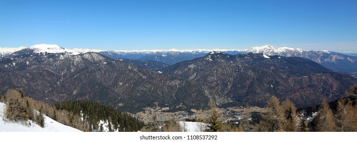 pranoramic view from Lussari Mountain in Northern Italy in winter with snow. The small town in the valley is Tarvisio