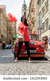 Praque Czech Republic: Jun 8 2018: Ms. Ildiko Horvath (Hungarian Supermodel model) in red top posing for photographers in down town Praque.