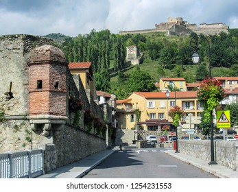 Prats de Mollo la Preste, Pyrenees-Orientales, southern France: Panoramic view of the medieval fortified town with Fort Lagarde and mountains at summer day - Shutterstock ID 1254231553