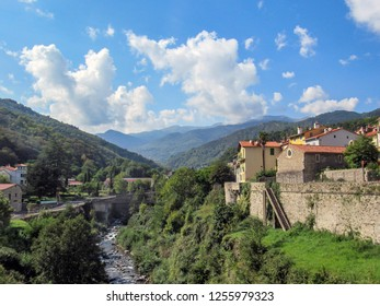 Prats de Mollo la Preste: Panoramic view of the medieval fortified town on the left bank of the Tech river and mountains Languedoc Roussillon, Pyrenees Orientales, southern France - Shutterstock ID 1255979323