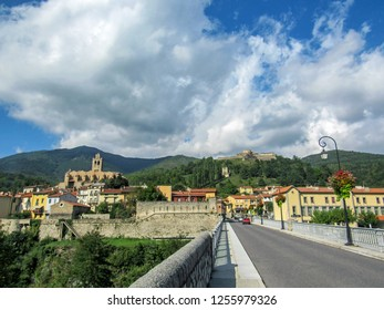 Prats de Mollo la Preste, Pyrenees-Orientales, southern France: Panoramic view of the medieval fortified town with church of Saint-Juste-et-Sainte-Ruffine, Fort Lagarde and mountains at summer day - Shutterstock ID 1255979326