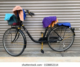 Praves,Bangkok,Thailand. October 18,2019 : Bicycle more useful than shopping is a temporary place to hang clothes.