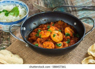 Prawn curry with rice and popodoms