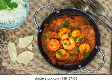 Prawn curry with rice and popodoms - top view