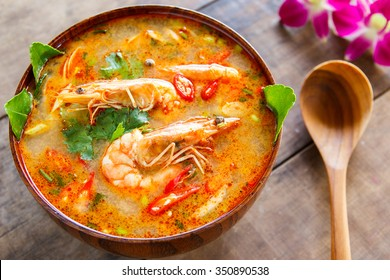 Prawn and lemon grass soup with mushrooms,Tom Yam Kung ,thai food in wooden bowl
