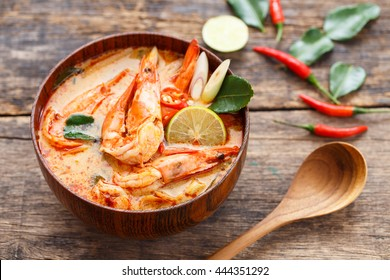 Prawn and lemon grass soup with mushrooms,Tom Yam Kung ,thai food in wooden bowl ,top view