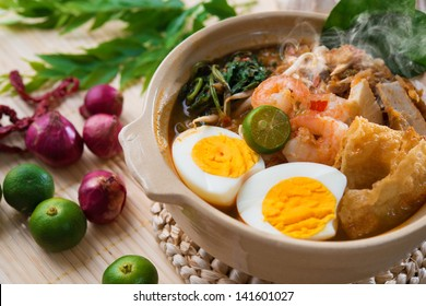 Prawn mee, prawn noodles. Famous Malaysian food spicy har mee fresh cooked in clay pot with hot steam.