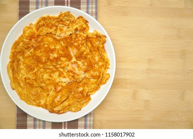 Prawn with Omelet (Omelette, Scramble eggs) on wooden background. Quick and easy to cook. Still life food. Delicious. Copy space.