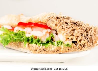 Prawn sandwich on white plate. Studio shot