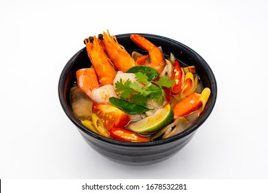 Prawn Tom Yum, Thai famous food called Tom Yum Goong hot and spicy soup on white background