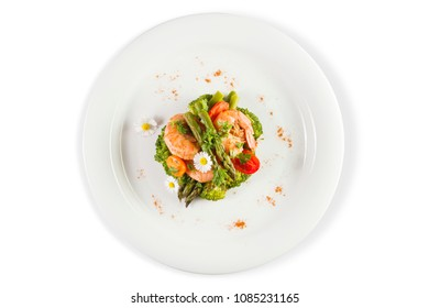 Prawns, asparagus and broccoli with edible daisy flowers. Top view. Isolated on white.