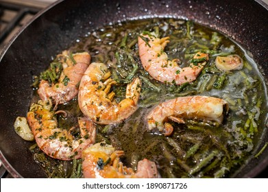 sautéed prawns and asparagus in a pan for seasoning