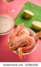 Prawns  in the ceramic bowl on the pink background