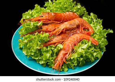 prawns with fresh salad on dish