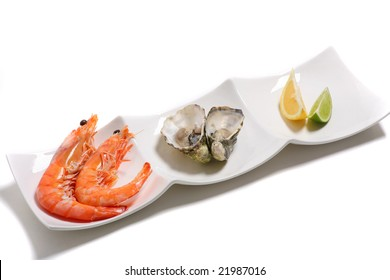 Prawns and oysters on a plate with copy space for text