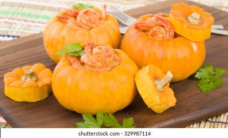Prawns in Pumpkin (Camarao na Moranga) - Prawns with a creamy coconut milk sauce served inside a roasted pumpkin.
