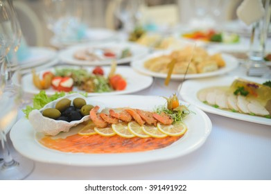 prawns and red fish with lemon and olives