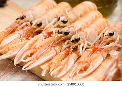 prawns and shrimp raw ready to be cooked on a wooden table in the kitchen