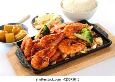 Prawns stir fry served on a sizzling plate