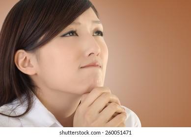 Pray concept of Asian business woman portrait.