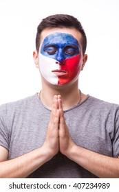 Pray of Czech Republic. Czech football fan pray for game Czech Republic national team on white background. European football fans concept.