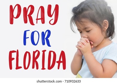 Pray for Florida.Little girl hand praying on Rain, wind and storm surge.Hurricane Irma Pray for Florida and American people the symbol of humanity for Hurricane natural disaster in Florida.