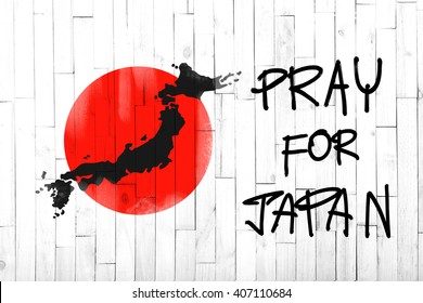 pray for japan text on white wood background
