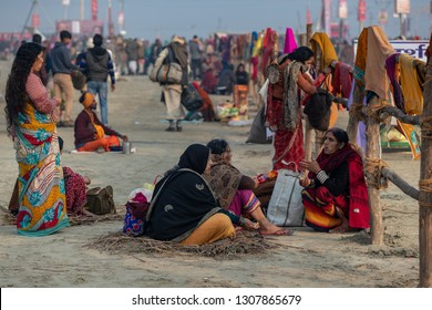 Prayagraj (formerly Allahabad),India- January 14,2019: Pilgrims in Kumbh Mela.So many Hindu people comes to Kumbh area prior to first holy bath.Most of them stay in tents.They bath and pray   in Ganga