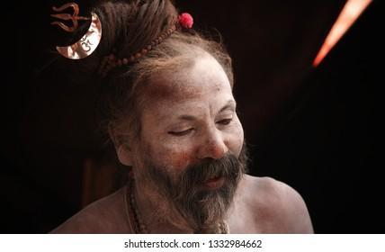 Prayagraj / India - February 6, 2019: Naga sadhu in Kumbh mela, prayagraj, with dreadlocks, Rudraksh beads, and traditional holy costumes.