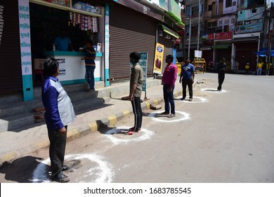 Prayagraj: People maintain social distance as they buying medicine during lockdown in wake of corona virus pandemic in Prayagraj on Thursday, March 26, 2020.
