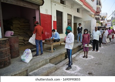 Prayagraj: People maintain social distance as they in queue to receive free ration during lockdown in wake of Coronavirus pandemic in Prayagraj on Thursday, April 02, 2020.