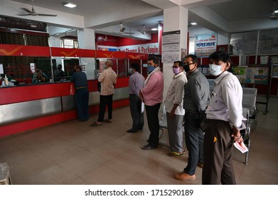 Prayagraj: People maintain social distance at a Post office during a government-imposed nationwide lockdown as a preventive measure against the COVID-19 coronavirus, in Allahabad on April 27, 2020.