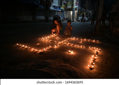 Prayagraj: Resident light candles to observe a 9 minute vigil called by India's prime minister in show of unity and soldierly in the fight against the coronavirus.