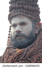 Prayagraj, Uttar Pradesh / India - February 03 2019: Portrait of a naga sadhu wearing rudraksh beads at the Kumbh Mela in Prayagraj