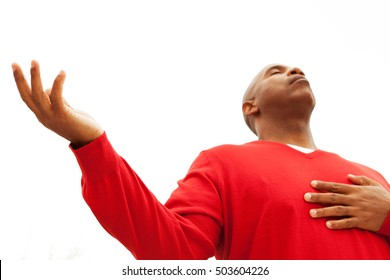 Prayer. African American man with open arms.
