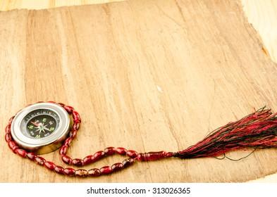 Prayer beats with compass