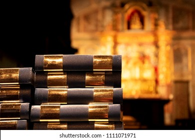 Prayer books and blurry altar at background. Religion concept. Selective focus.