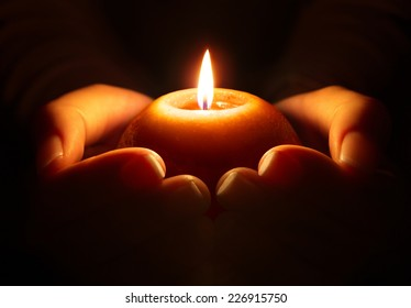 prayer - candle in hands