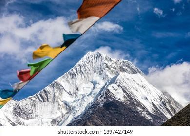 prayer flag under snow mountain in China