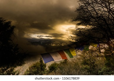 Prayer flags and cloudy mountain view