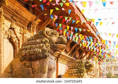 Prayer flags and decorations are held over Patan Durbar Square in Kathmandu, Nepal, during Krishna's birth festival celebrations.