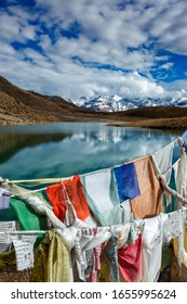 Prayer flags lungta with Buddhist mantra written on them and Dhankar Lake. Spiti Valley, Himachal Pradesh, India