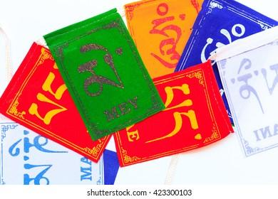 "Prayer Flags, ""Om Mani Padme Hum"" on multicolored flags."