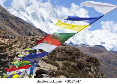 Prayer flags,  strung along mountain ridges and peaks high in the Himalayas
