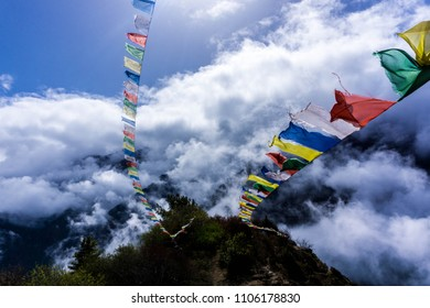 Prayer flags in wind and clouds at daylight