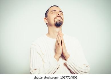 Prayer. Man in pullover