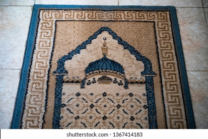 The prayer mat patterned image of mosque. Usually for solah, pray to God. In Indonesia it was called sajadah.