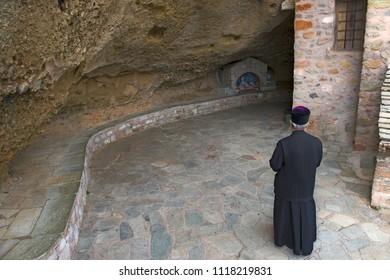 prayer Orthodox monk in the monastery of Meteora, Greece.