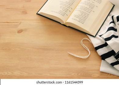 Prayer Shawl - Tallit and Prayer book jewish religious symbols. Rosh hashanah (jewish New Year holiday), Shabbat and Yom kippur concept